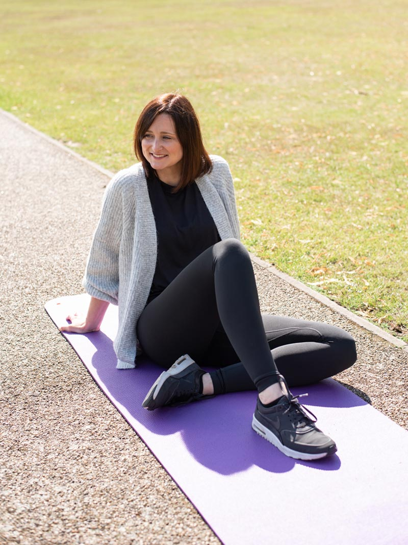 Sophie outside on a yoga mat