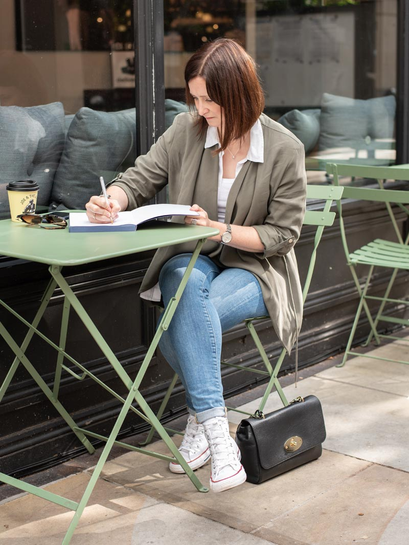 Sophie Writing at a Cafe